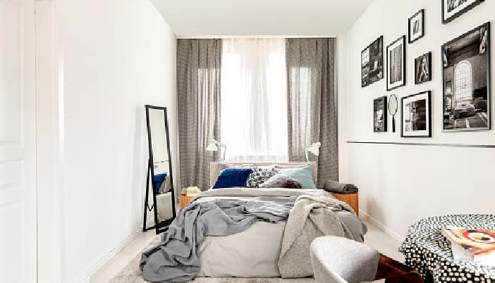 How can I decorate my small bedroom on a budget?